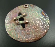 made with copper clay...it could also be done using polymer clay with mica powders, or with Swellegant Metal Coatings...