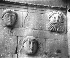 """Hatra S liwan [Palace - S Liwan - detail of sculptured heads on pilaster. """"And more curious still, high up on the walls in the interior of the halls they set huge human heads in groups of three, and these too are sometimes dimly classical, a Medusa head, a bearded river god; and sometimes they are wild and staring masks, scarcely human"""