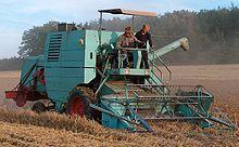 Mules pull farm equipment (3537172980) - Combine harvester - Wikipedia