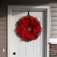 This handmade Poinsettia wreath is made with red and green burlap! The glitter ornaments make the wreath stand out even more! I recommend to hang the wreath not in direct sunlight if you dont want the yellow to fade! The best place is to hand it under a covered porch or overhang to protect it from the direct weather! This wreath would be a great welcome to your guests! Size: around 22 inches If you have a different color in mind, please dont hesitate to contact me