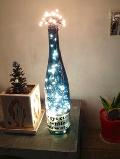 Put Christmas lights in a wine bottle for a creative light piece