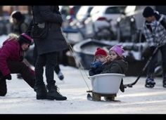 something to make for future winters: baby bath attached to old skis to make a sled.