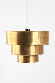 If you want to free up limited space on your nightstands, try hanging these Triple Tiered Pendant Shades ($64) on either side of your bed for a dose of deco drama.