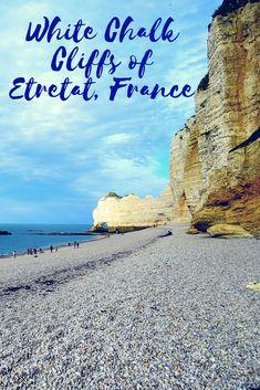 Etretat France   Etretat Normandy  Natural Chalk Cliffs   Etretat Beach   Etretat Travel - The pebble beach is flanked by imposing natural arch chalk cliffs which are a popular tourist destination.