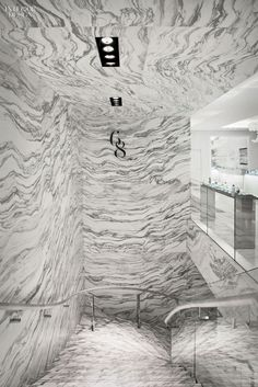 Italian marble all over + leather wrapped handrails = luxury
