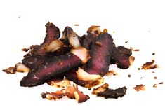 The best biltong recipe is one that stays true to South African jerky. Salt, black pepper, paprika and red wine vinegar are hallmarks of this world-renowned meat recipe. Meat Dehydrator, Biltong, Meat Recipes, Stuffed Peppers, Vinegar, Red Wine, Salt, African, Food