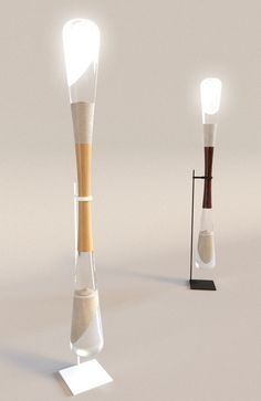 """... this human-powered hourglass lamp that draws its energy elegantly from grains of falling sand"""
