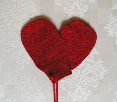"""Little mittens for that little one who pulls on those heart strings with just one look. Just like my Grandma always made them – with string to keep them together, and cute little buttons to """"pretty them up"""" a bit."""