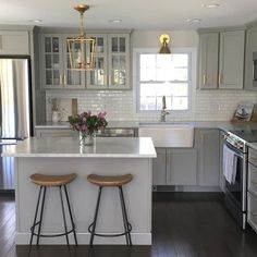 cool Gray Kitchen Cabinets with Lewis Dolan Brass Bar Pulls - Transitional - Kitchen