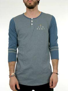 • 100% cotton jersey slub Henley shirt. • Three-quarter length sleeves. • Contrast stripes. • Logo screen-print.