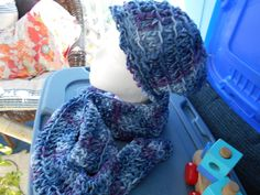 Blues Touched by Purple Hand Made Hat N Scarf. Colors are Light Blue to Dark Blue and are made of acrylic yarn. Hand wash and hang to dry.