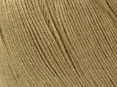 100% Pure Bamboo ~ Beige  ~  Free Shipping Sleek, soft, 'drapey' and airy, bamboo yarn is obtained from the pulp of the bamboo plant and ideal for cool breathable lightweight knitted garments. Nice summer pure bamboo fine yarn.  8 Balls per bag. Not sold individually  Fiber Content: 100% Bamboo