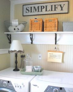 love the gray and yellow laundry room