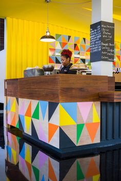 British designer Morag Myerscough has created brightly coloured textiles, tiles and furniture for the cafe inside the Bernie Arts Centre in London
