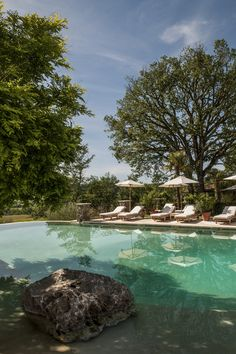 Borgo Santo Pietro in Tuscany has a large lagoon style infinity swimming pool with glorious views of the wooded valley; a haven of tranquillity http://www.mediteranique.com/hotels-italy/tuscany/borgo-santo-pietro