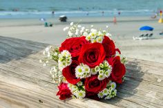 red rose and mini daisy bouquet by Reynolds Tresures