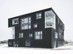 "Completed in 2012 in Blaricum, The Netherlands. Images by Christian Richters. The project ""Black & White Twins"" experiments with the spatial and visual integration of compact collective housing solutions in the new. Contemporary Architecture, Amazing Architecture, Monochromatic Color Scheme, Best Architects, Brick Facade, Social Housing, Composition Design, Amazing Buildings, Amazing Houses"