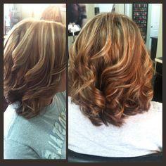 Medium length brown hair with blonde highlights.