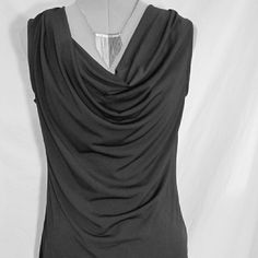 H&M»draped tank NWOT Basic draped tank top in black. Dress up or down for work or play. Poly/elastane blend. Received as a gift but it's slightly too small for me. New without tags, TTS. H&M Tops Tank Tops