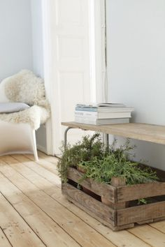 """Ausbau Apartment Wiesbaden is a minimalist house located in Wiesbaden, Germany, designed by Studio Oink. A small apartment in a popular area in Wiesbaden, familiarly, quiet and bright, these were some wishes of the flat owners. The designers created a light atmosphere with a touch of nature by using natural materials and old furniture.  They painted the walls in """"grey"""" and """"patina"""" to make it more open and roomy. They also exposed the original wood flooring and placed ceramic tiles with a…"""