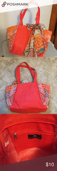 """Cute Tote! This is a small tote. It features double handles, burlap-like orange fabric accented with floral chiffon covered sides.Same floral chiffon is tied in bow on front of bag. Inside features one zippered pocket. Top zippered closure. Measures 15 1/2"""" x 10"""" x 4"""".Excellent unused condition! cypress home Bags Totes"""