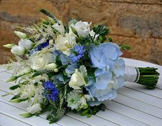 """Lovely """"Wildflower"""" Style Hand Tied Wedding Bouquet Featuring: Blue Hydrangea, Blue Nigella, White Roses, White Freesia, White Lisianthus + Buds, White Veronica & Greenery"""