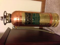 Fire extinguisher - copper and brass circa 1940's  My dad made several lamps out of these when I was young!