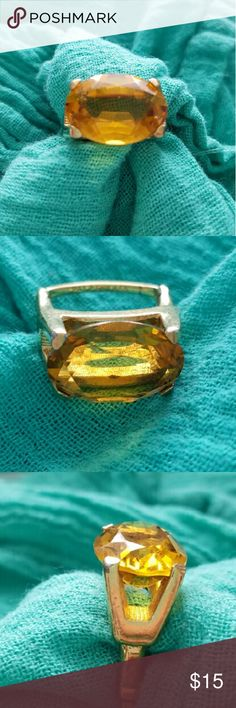 $10 SALE! Faceted Citrine Stone Adjustable Vintage One of my most favorite pieces in my personal collection but I MUST downsize to make room for new stuff! A large oval shaped created citrine ring in prong setting on a gold tone adjustable band. Shows a tiny bit of wear on one side where is adjusts but it's covered by your finger so barely noticeable. Everyone will be busy looking at the stone anyway! Adjusts from size 5.25 to 7.25. Vintage Jewelry Rings