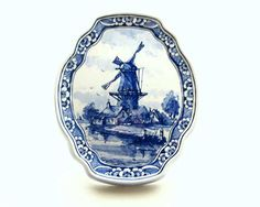 Classic Dutch Blue 'Delft' Ceramics, depicting windmills, and traditional farm imagery.