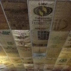 Black bear coffee shop in Hendersonville, NC. They use burlap coffee sacks to decorate the ceiling, the photo doesn't do it justice. Home Ceiling, Ceiling Tiles, Mobile Coffee Shop, Burlap Sacks, Van Interior, Coffee Shop Design, Tiny House Cabin, Massage Room, Basement Remodeling