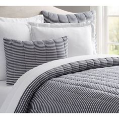 Pottery Barn Mini Stripe Comforter ($139) ❤ liked on Polyvore featuring home, bed & bath, bedding, comforters, striped pillow shams, pottery barn, reversible comforters, white striped comforter and pottery barn pillow shams