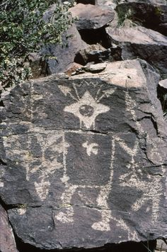 """Star-Kachina petroglyph. Galisteo Basin and the upper Rio Grande area in New Mexico. Note Eagle tail headdress and star head. Photo: Peter Faris  """"Possibly records the spectacular appearance of Halley's Comet in AD 1301, as well as its evolution into a specific sacred being among the kachinas of the Ancestral Puebloan pantheon, and its subsequent influence on their culture."""""""