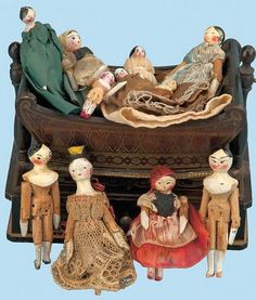 Early peg wooden and paper mache dolls.