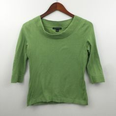 "Green 3/4 Sleeve Top Pre-loved; great condition, no holes or stains.  Made of 87% cotton/8% nylon/5% Lycra spandex Size S Measurements: Under arm to under arm flat across is approx. 17"".  Back of neck to bottoms hem is approx. 22"". Banana Republic Sweaters Crew & Scoop Necks"