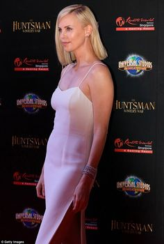Charlize Theron wears a white gown at The Huntsman: Winter's War premiere in Singapore | Daily Mail Online