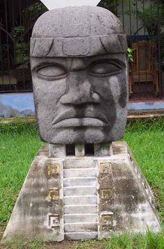 The colossal heads are commanding portraits of individual Olmec rulers, and the large symbol displayed on the 'helmet' of each colossal head appears to be an identification motif for that person.
