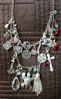 DIY charm necklace with old jewelry. I'm sure I could make this. I'm excited to try, too!