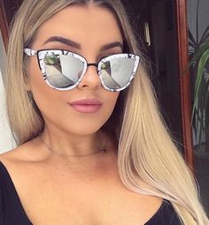 These modern cat eye sunnies feature plastic coated metal frames, curved arms, as well as both mirrored and non-mirrored options. Polycarbonate and Metal Frame. Polycarbonate Lens. Steel Hinges. 100%
