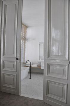 En suite bathroom inside a hotel by Belgian office AIDarchitecten. Classical modern.