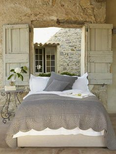 grey bedding with off white sheets and maybe a white painted distressed bed