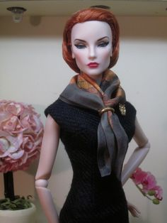 Elise is the picture of classic elegance in this sheath and scarf ensemble from Inside the Fashion Doll Studio and Bellissima Couture. The figure hugging split neck sheath is made from black raw s…