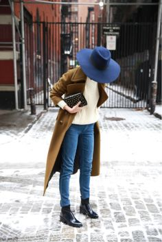 Big hat, blue jeans, a structured coat and patent black boots to welcome the cooler months ahead / the love assembly