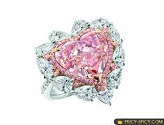 Fancy pink colored pink heart shaped diamond cluster ring.