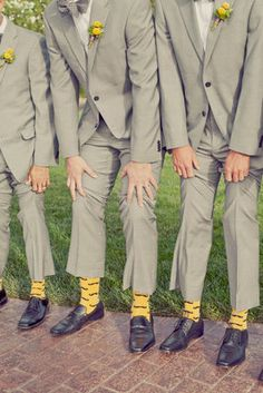 Yellow socks for the groomsmen! Photo by onelove photography. #ThePerfectPalette