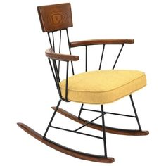 Iron and Oak Rocking Chair by Richard McCarthy for Selrite | From a unique collection of antique and modern rocking chairs at https://www.1stdibs.com/furniture/seating/rocking-chairs/