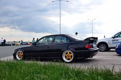 Black BMW e36 coupe on gold&polished BBS RF cult wheels