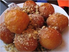 In Greece, loukoumades are commonly spiced with cinnamon in a honey syrup and can be sprinkled lightly with powdered sugar. In ancient Greece, these deep fried dough balls were served to the winners of the Greek Olympics. Greek Sweets, Greek Desserts, Greek Recipes, Beignets, Yummy Treats, Yummy Food, My Best Recipe, Mediterranean Recipes, Love Food
