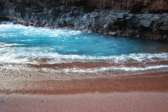 That little blue pool on that remotelittle red sand beach in Hana Bay, Maui.