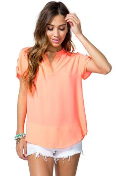 Make a run for it! A boxy tee featuring a split round neck and short sleeves with button tabs. Finished hem. Woven.
