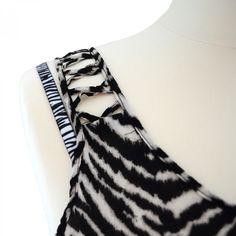 Zebra Print White bra straps matched with zebra print vest.
